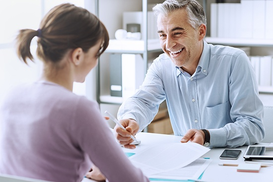 Rewards and benefits, manager discussing with an employee