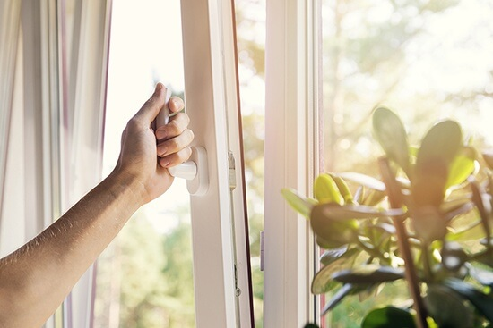 Main product, hand opening a PVC window