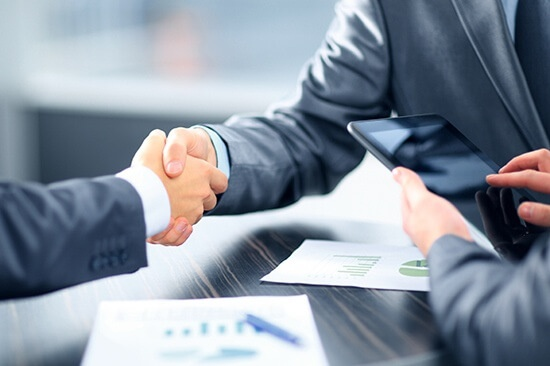 Reliable, businessmen shaking hands