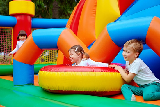 PVC in the household and consumer products industry, children playing on an inflatable playground