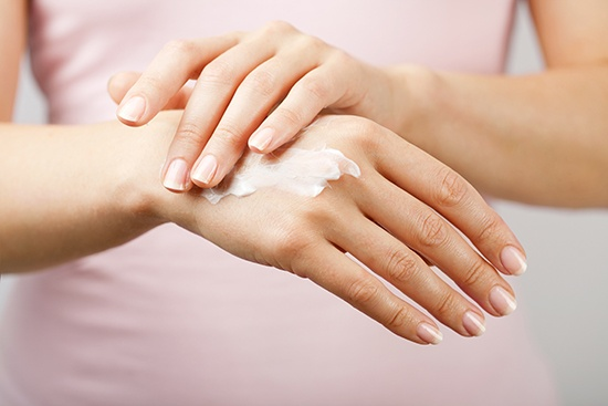Consumer care application, hands applying lotion
